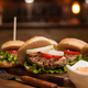 Meat beef in delicious burgers with fresh lettuce in restaurant - PhotoDune Item for Sale
