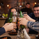Group of happy friends drinking and toasting beer at brewery bar restaurant - PhotoDune Item for Sale