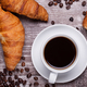 Cup of hot coffee and freshly baked croissants on dark wooden table - PhotoDune Item for Sale