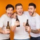 Three men holding beer and celebrating meeting over background - PhotoDune Item for Sale