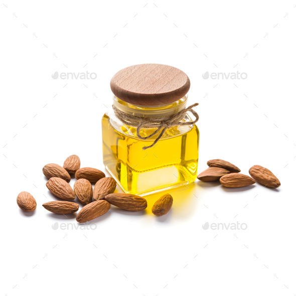 Bottle of almond oil on white - Stock Photo - Images