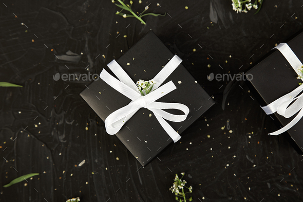 Wrapping modern Christmas or Birthday gifts presents - Stock Photo - Images