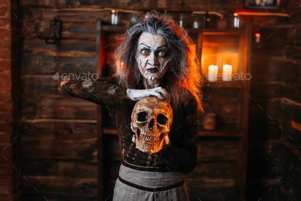 Witch reads the spell, ritual with human skull - Stock Photo - Images