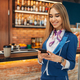 Stewardess using mobile phone in airport cafe - PhotoDune Item for Sale