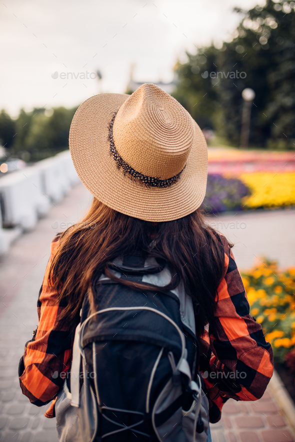 Female hiker with backpack on excursion, back view - Stock Photo - Images