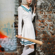 Anime girl with baseball bat in abandoned factory - PhotoDune Item for Sale