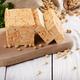 Soy Bean curd tofu on cutting board and in hemp sack on white wo - PhotoDune Item for Sale