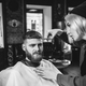 Client during beard shaving in barber shop - PhotoDune Item for Sale
