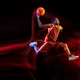 Young basketball player against dark background - PhotoDune Item for Sale