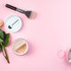Beige face powder and brush for make up, rose, cup of coffee on pink background with copy space - PhotoDune Item for Sale