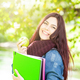 Female student holding an green apple. - PhotoDune Item for Sale