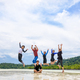 Happy family jumping together on the beach, Thailand - PhotoDune Item for Sale