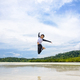 Happy asian woman jumping fun on the beach - PhotoDune Item for Sale