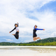 Two asian teen girls friends jumping enjoy on the beach - PhotoDune Item for Sale