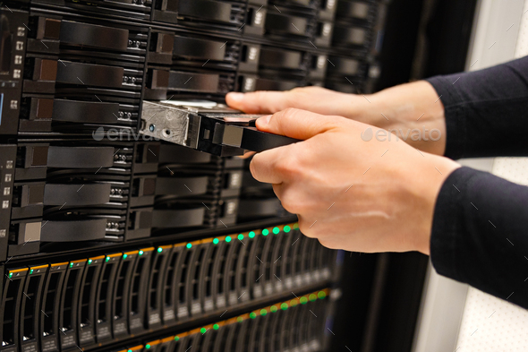 Male IT Technician Replacing Server Drive In San - Stock Photo - Images