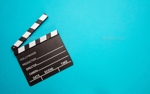 Movie clapperboard on blue color background, top view - Stock Photo - Images