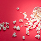 Pop corn scattered on red color background, closeup view - PhotoDune Item for Sale