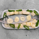 raw sea bass ready to be roasted on gray marbled background - PhotoDune Item for Sale
