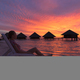 Girl on a deck chair enjoying the sunset in the Maldives - PhotoDune Item for Sale