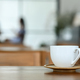 Coffee white mug on wooden floor in cafe. - PhotoDune Item for Sale
