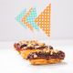 Food, desserts and bakery concept - Eclairs with chocolate decorated as a ship - PhotoDune Item for Sale