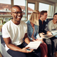 Smiling African businessman sitting with colleagues in a modern office - PhotoDune Item for Sale