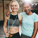 Two young women smiling after a gym workout together - PhotoDune Item for Sale