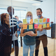 Designers laughing together while brainstorming ideas in an office - PhotoDune Item for Sale