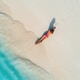 Aerial view of the back of sexy woman on the sandy beach - PhotoDune Item for Sale