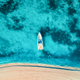 Aerial view of the white yacht in the clear blue water - PhotoDune Item for Sale