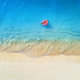 Aerial view of a swimming woman in the sea at sunset - PhotoDune Item for Sale