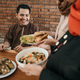 muslim male being served with food for break fasting - PhotoDune Item for Sale