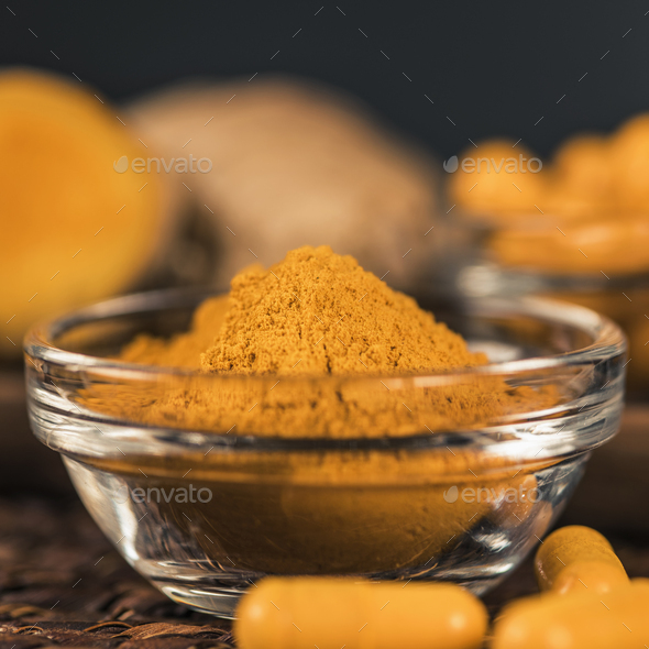 Turmeric Powder and Curcumin Herbal Supplement Capsules - Stock Photo - Images