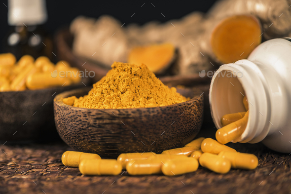 Curcumin Herbal Supplement Capsules and Turmeric Powder - Stock Photo - Images