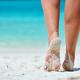 Woman walking on tropical white sand beach - PhotoDune Item for Sale