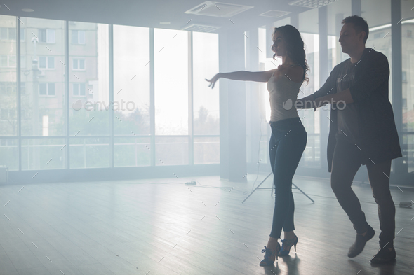 Couple of dancers showing their beautiful style of kizomba - Stock Photo - Images