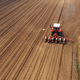 Aerial view of tractor with mounted seeder performing direct see - PhotoDune Item for Sale
