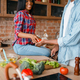 Black couple cooking together on the kitchen - PhotoDune Item for Sale