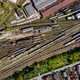 Aerial drone view of old locomotive train depo, parking iron horses on railway routes. Diesel engine - PhotoDune Item for Sale