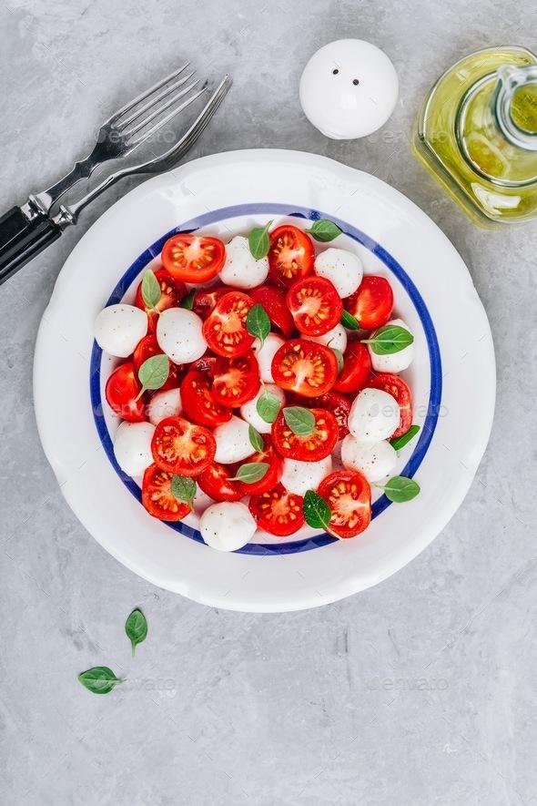 Caprese Italian salad with tomato, mozzarella and basil. Top view - Stock Photo - Images