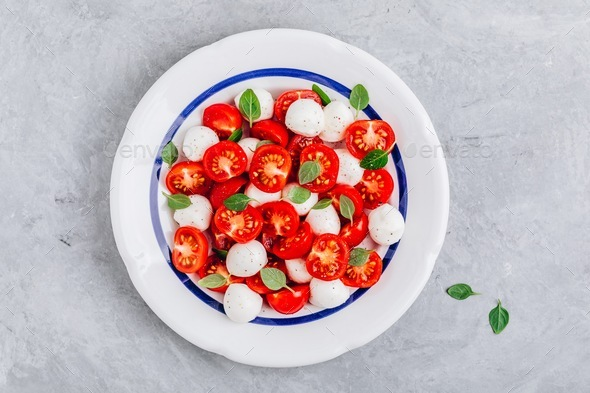 Caprese Italian salad with tomato, mozzarella and basil. Top view - Stock Photo - Images