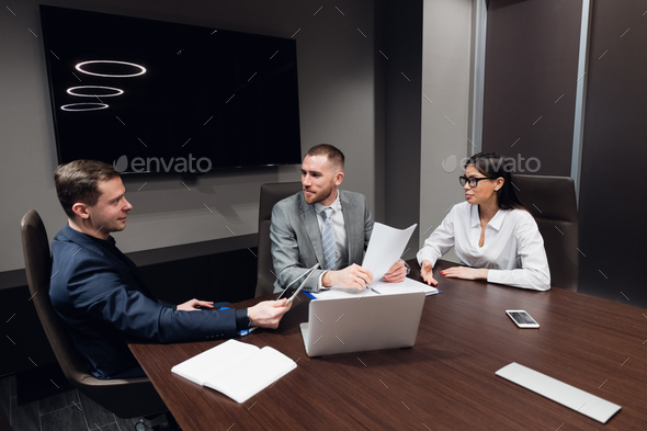 Startup business, creative business people of different age and races gather in meeting room in dark - Stock Photo - Images