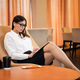 Confident businesswoman listening music on her tablet computer while sitting in chair in airport - PhotoDune Item for Sale