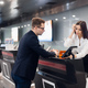 Staff At Airport Check In Desk Handing Ticket To Businessman - PhotoDune Item for Sale