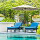 Beautiful outdoor swimming pool in hotel and resort with chair a - PhotoDune Item for Sale