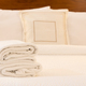 White towel on bed in hotel room - PhotoDune Item for Sale