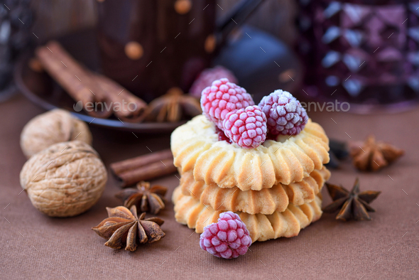 Shortbread cookies with frozen raspberries on brown background - Stock Photo - Images