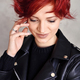 Portrait of a beautiful young red-haired woman with short hair - PhotoDune Item for Sale