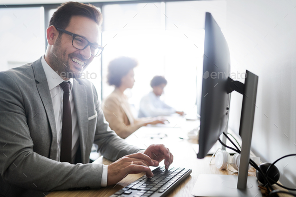 Successful business group of people at work in office - Stock Photo - Images