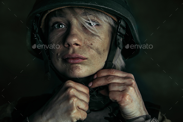 Portrait of young female soldier - Stock Photo - Images